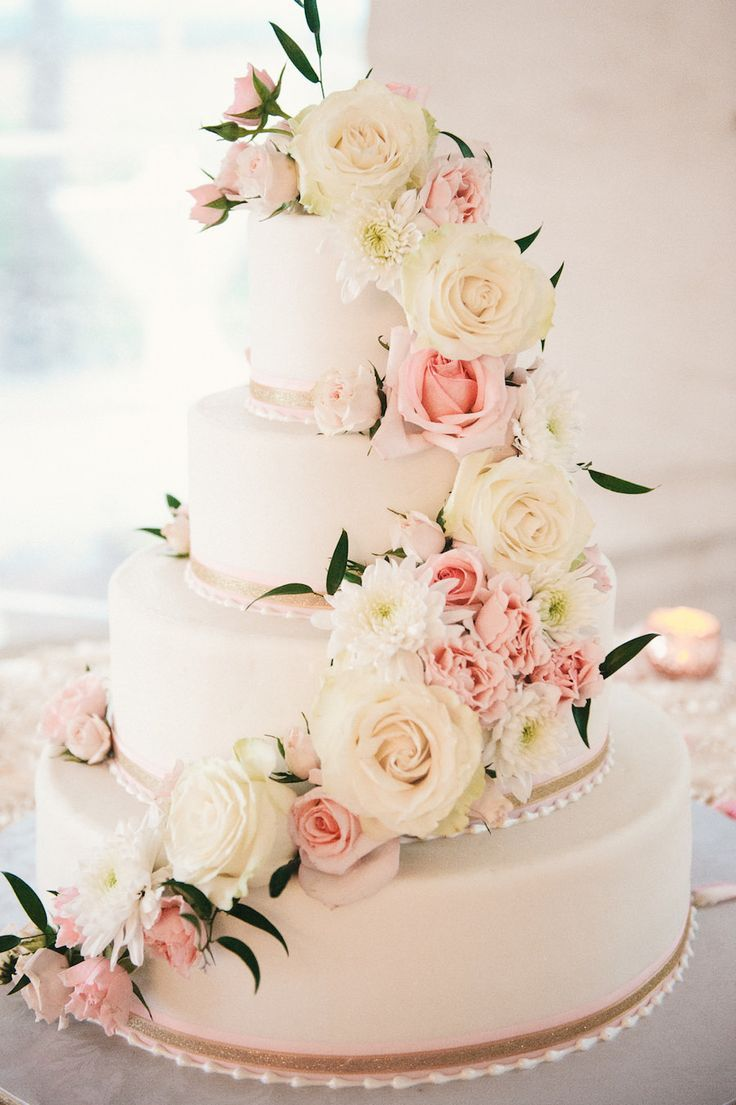 Four Tier Round White And Blush Pink Wedding Cake With Fresh Flower Roses Pearl Decoration On Specialty Linen