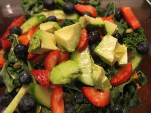 """Sunshine Salad"" - kale leaves + cucumber + carrot + strawberry + blueberry + pepitas + lemon juice + olive oil + avocado (add protein of choice)"