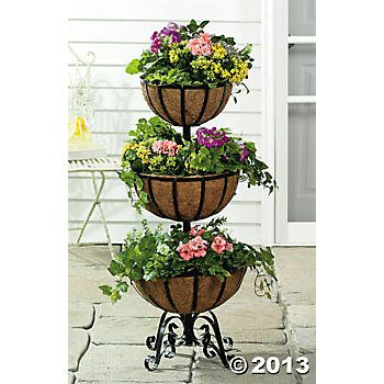 Three Tiered Flower Basket I Have This On My Deck Last 2 Summers I Ve Place A Fern On The Top It Gives It A More Tiered Garden Tiered Planter Flower Basket