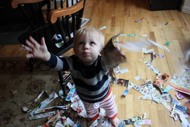 """Scraps of paper make an indoor """"leaf"""" pile to jump and play in."""