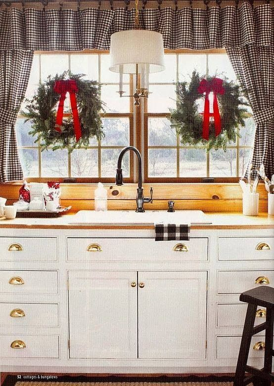 Wreaths in windows is a great way to add Christmas decor in kitchens
