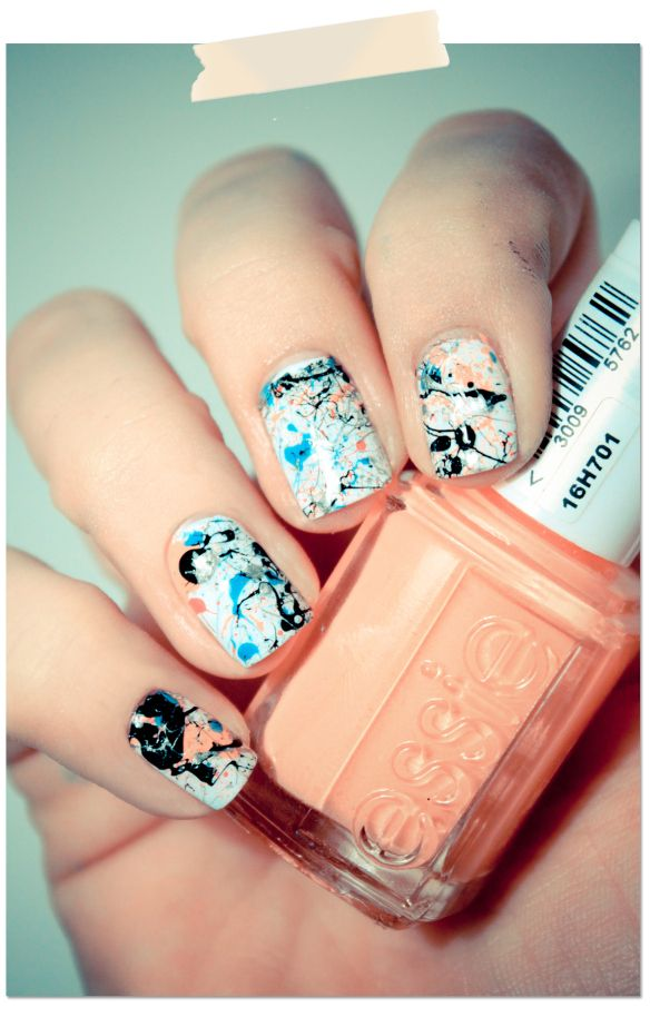 SPLATTER!! Dip the end of a straw in paint and blow.. Just make area around nails glued with Elmer's glue before hand.