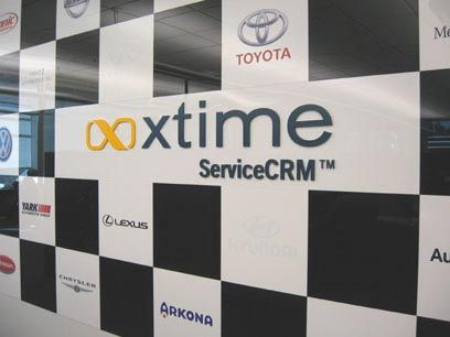 Custom Logo Wall For Xtime Service CRM Consisting Of Black And - Custom vinyl adhesive signs