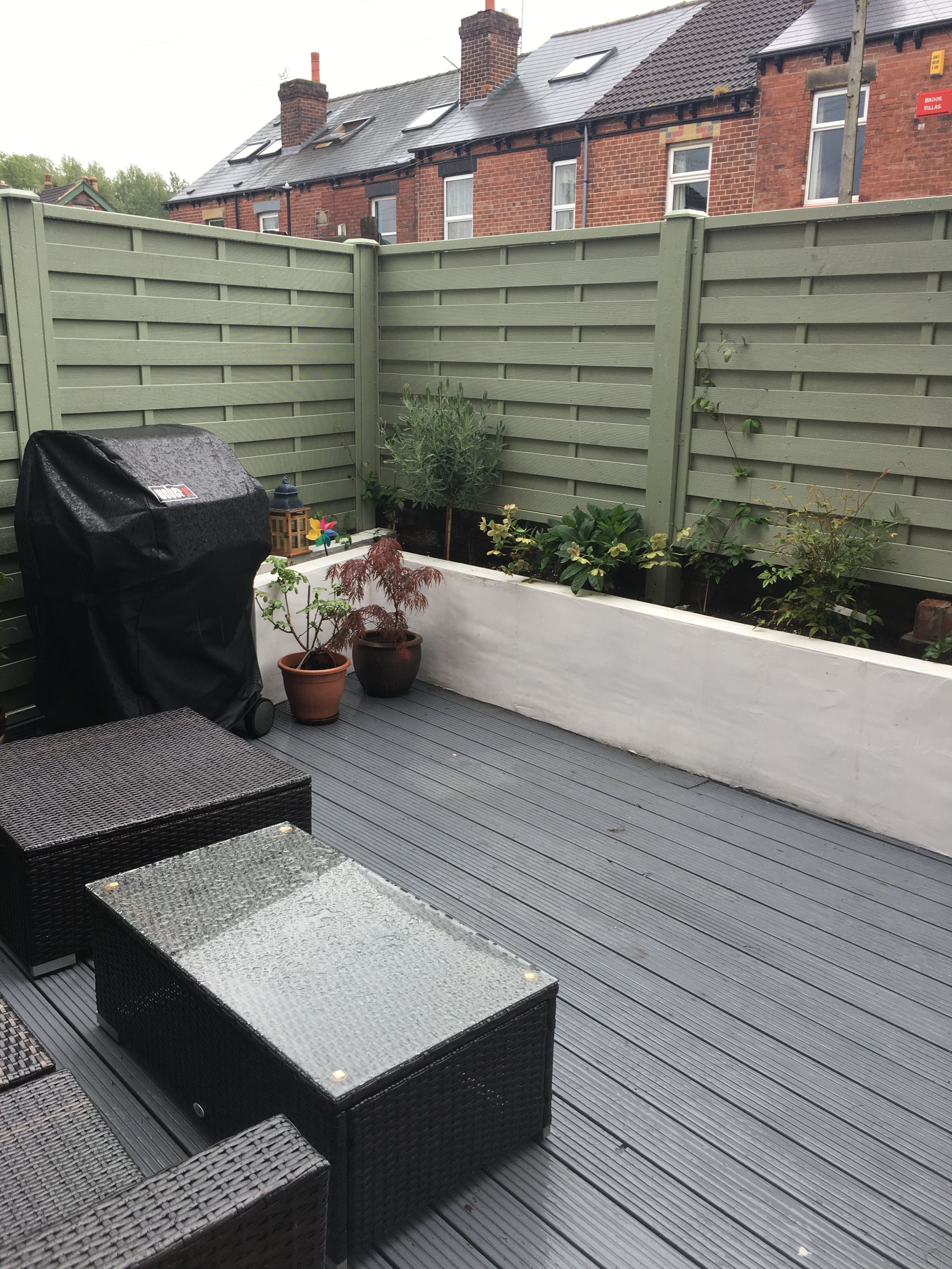 Garden olive green fencing white planters grey decking - Olive green and grey ...