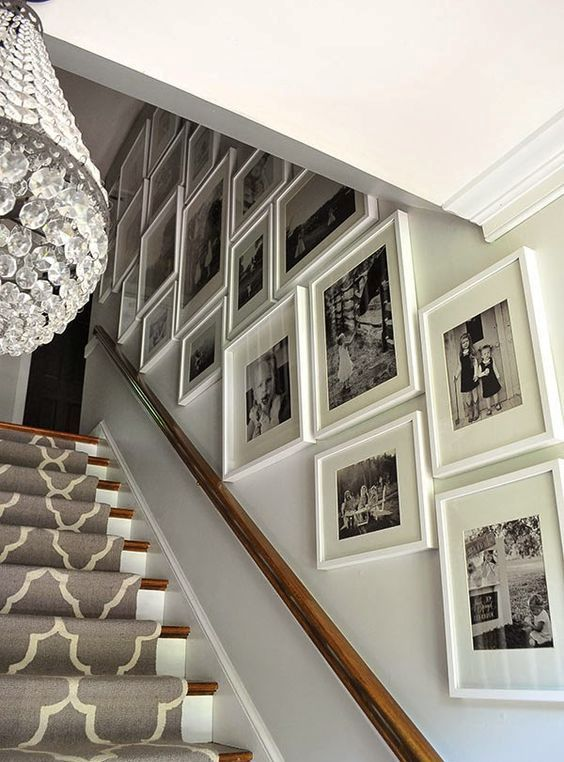 33 Stairway Gallery Wall Ideas To Get You Inspired: White Frames In Different Sizes But Same Style