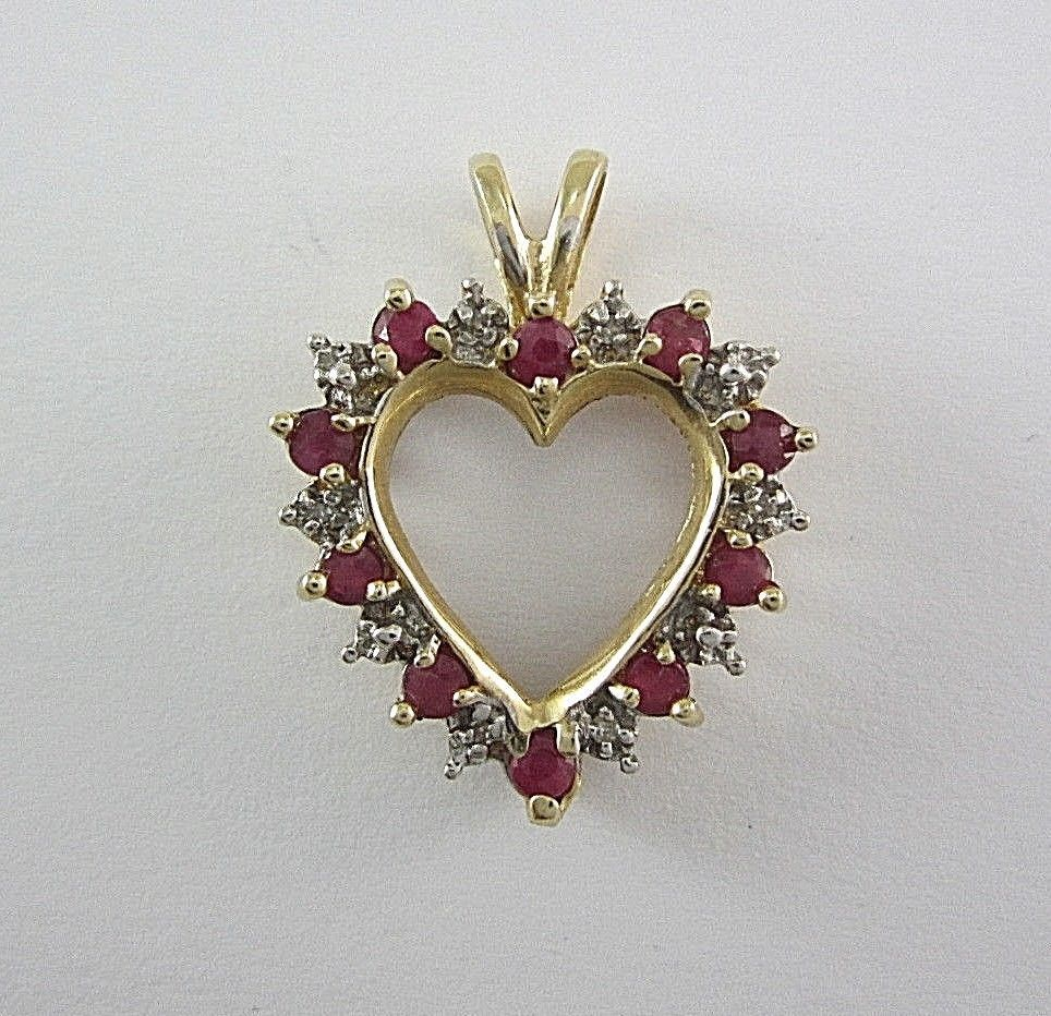 Ladies k yellow gold ruby and diamond heartshaped pendant tdw