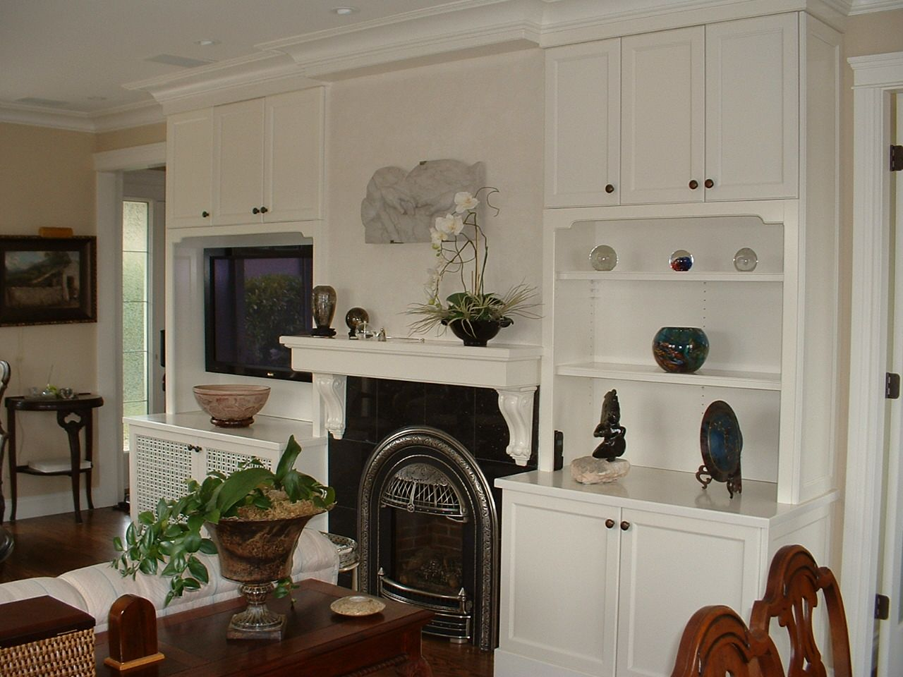 A traditional white fireplace wall unit designed by