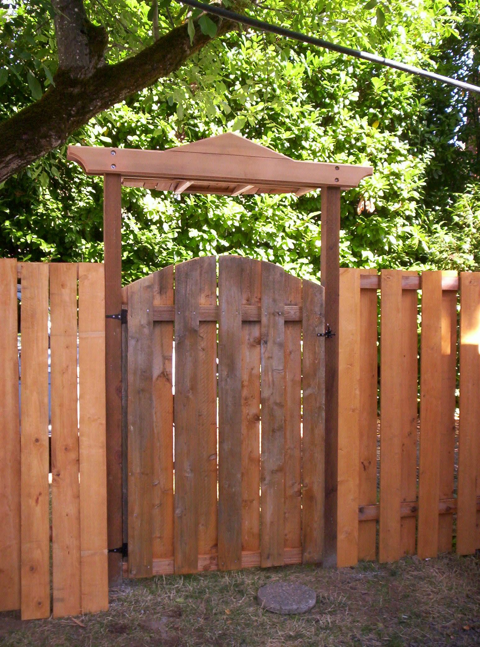arbor gates Cedar gate with flame motif, constructed