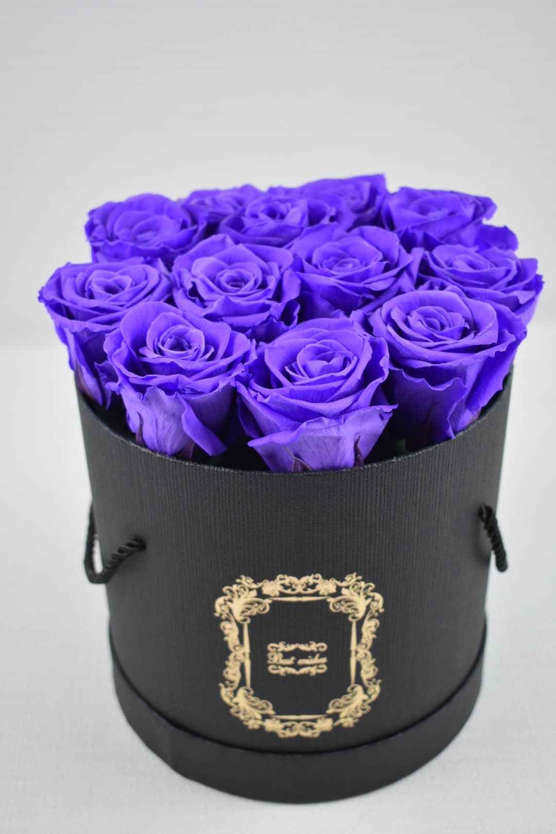 Send the Everlasting Roses purple Roses in a black box