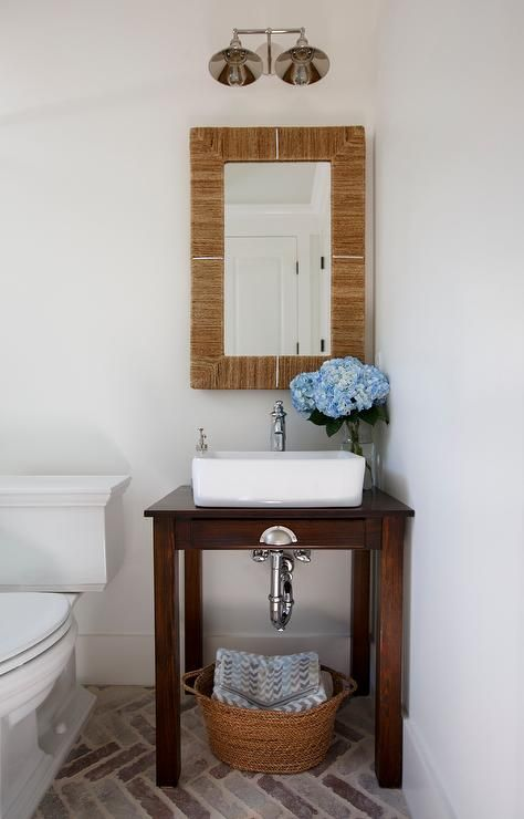 Chic cottage powder room features a small console table - Small powder room sinks ...