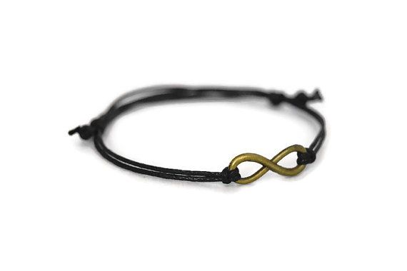 * Infinity charm cord bracelet  * Bronze tone metal charm  * 1mm waxed cotton cord available in a choice of colours  * Sliding knot fastening style