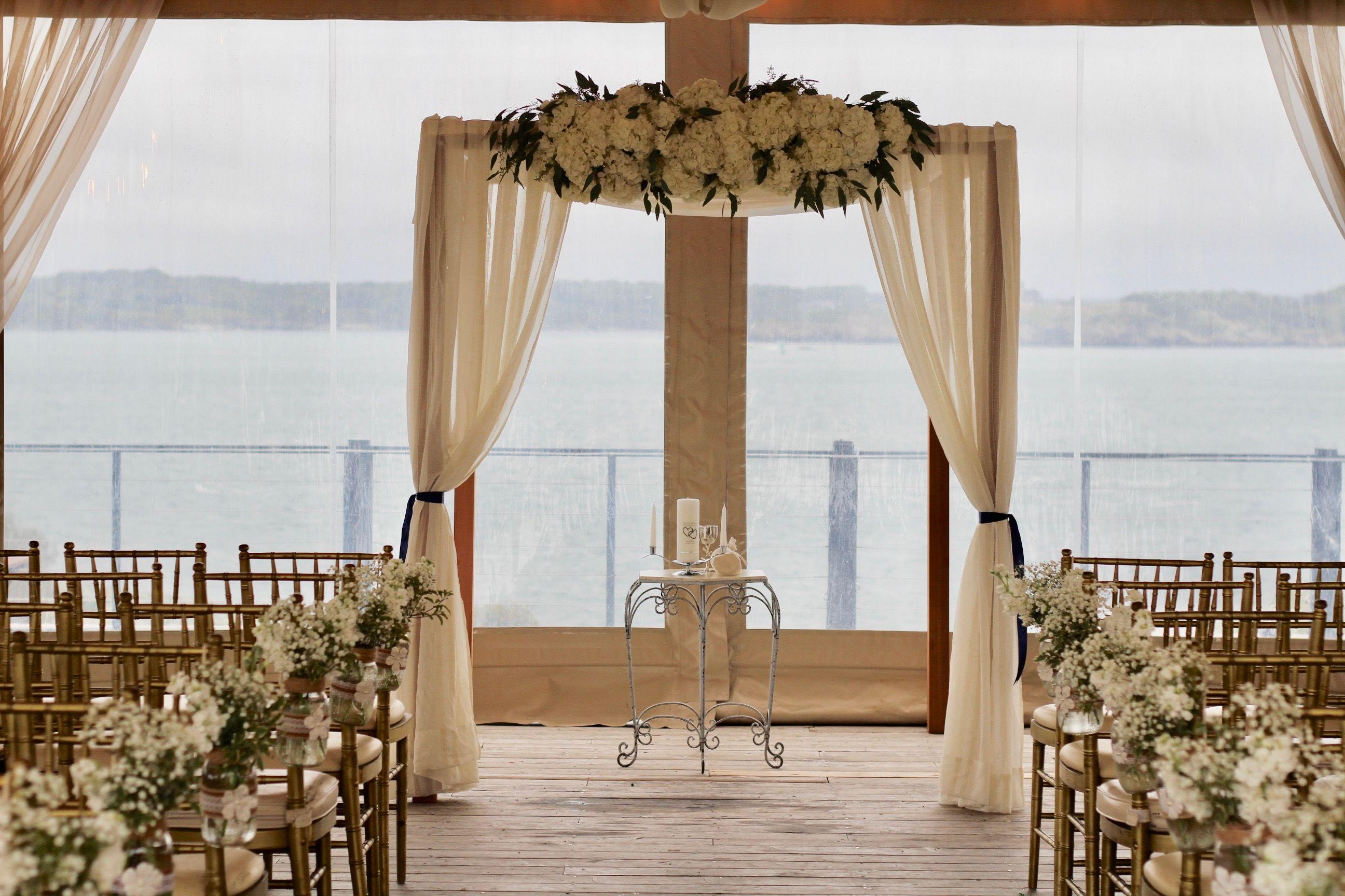 Our Cedar Chuppah With Ivory Curtains In A Simple Look