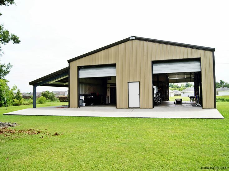 Steel garage building with two high overhead doors and a leanto on the side De