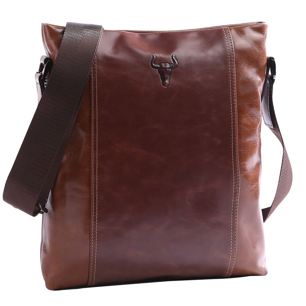 This beautifully crafted, quality leather messenger bag is versatile and functional. It is a great size for keeping your everyday essentials organized and right at your fingertips. It is worn across the body with an adjustable cloth strap.  This slim, medium satchel is made from chestnut brown genuine, shiny leather with silver metal styling details. It features a cloth lined main zipper compartment including a smaller zipper pocket, three large slot pockets, two card slots and two pen…