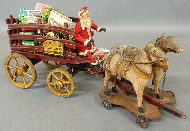 Santa Claus driving a painted horse pulled toy wagon, with