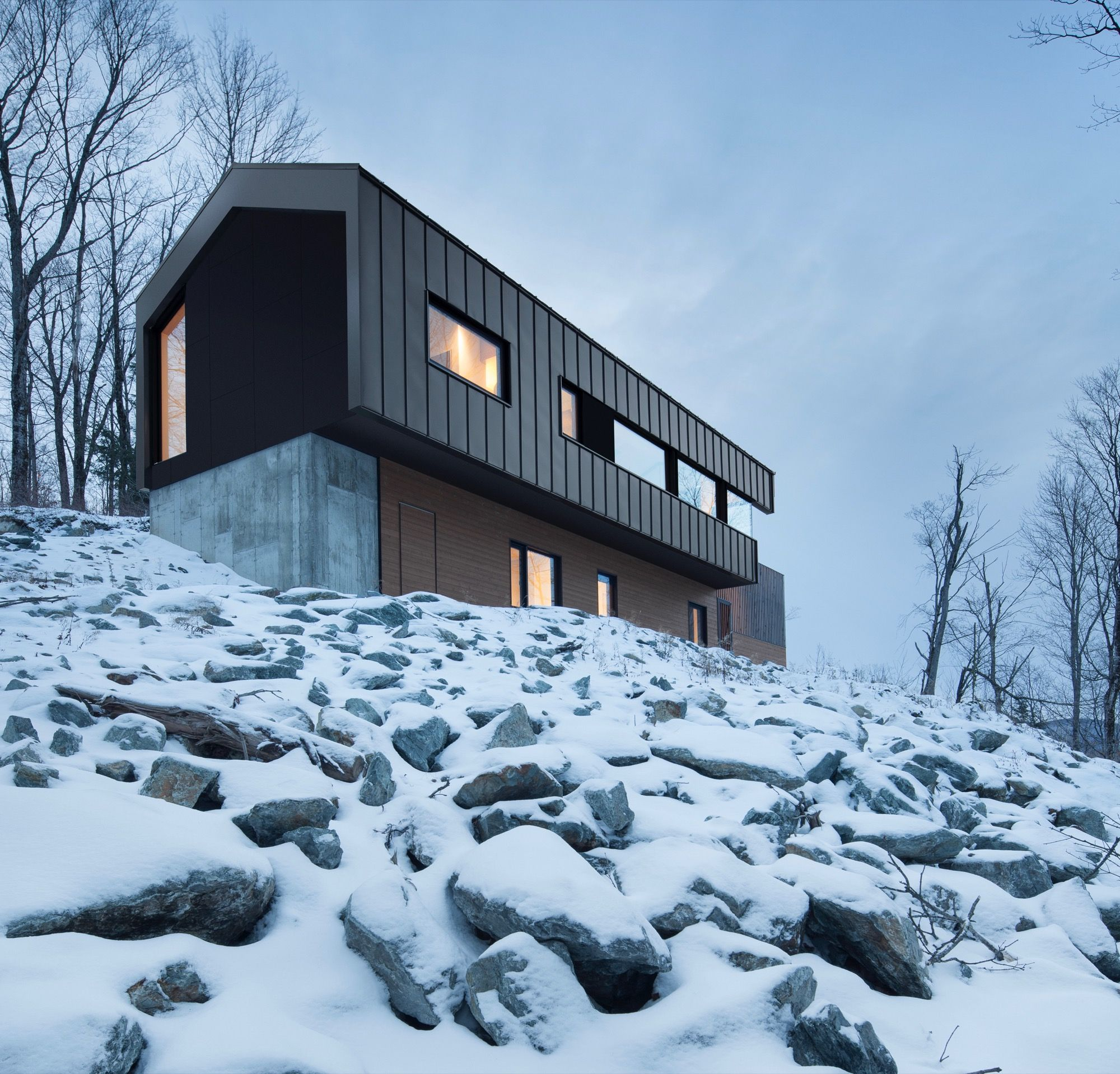 Built into the mountainside, a Quebec country house cantilevers over the treetops for magnificent views