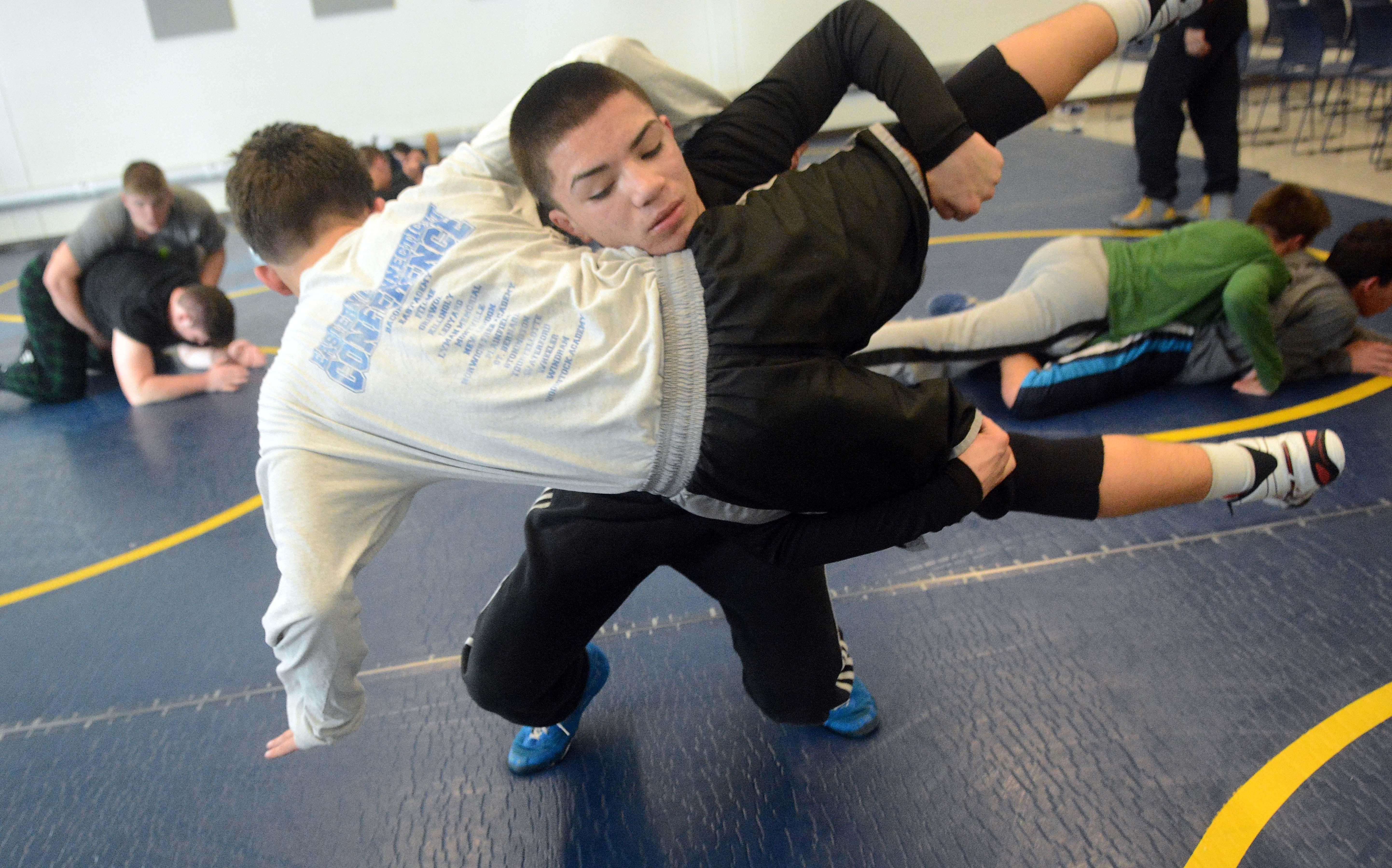 New England wrestling champ hopes to lift Ellis Tech to
