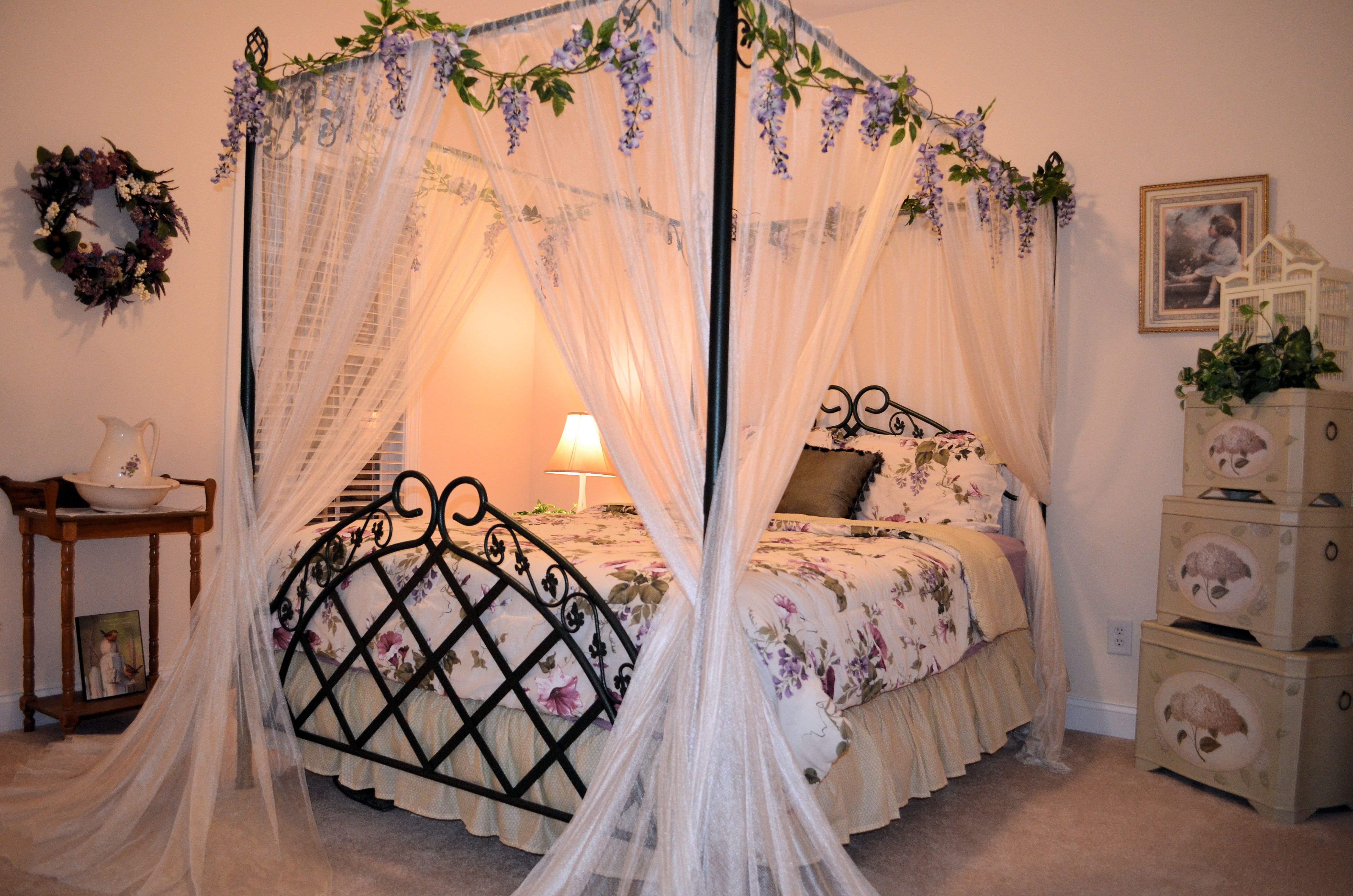Canopy Bed With Hanging Wisteria Garland Home Home Decor Decor