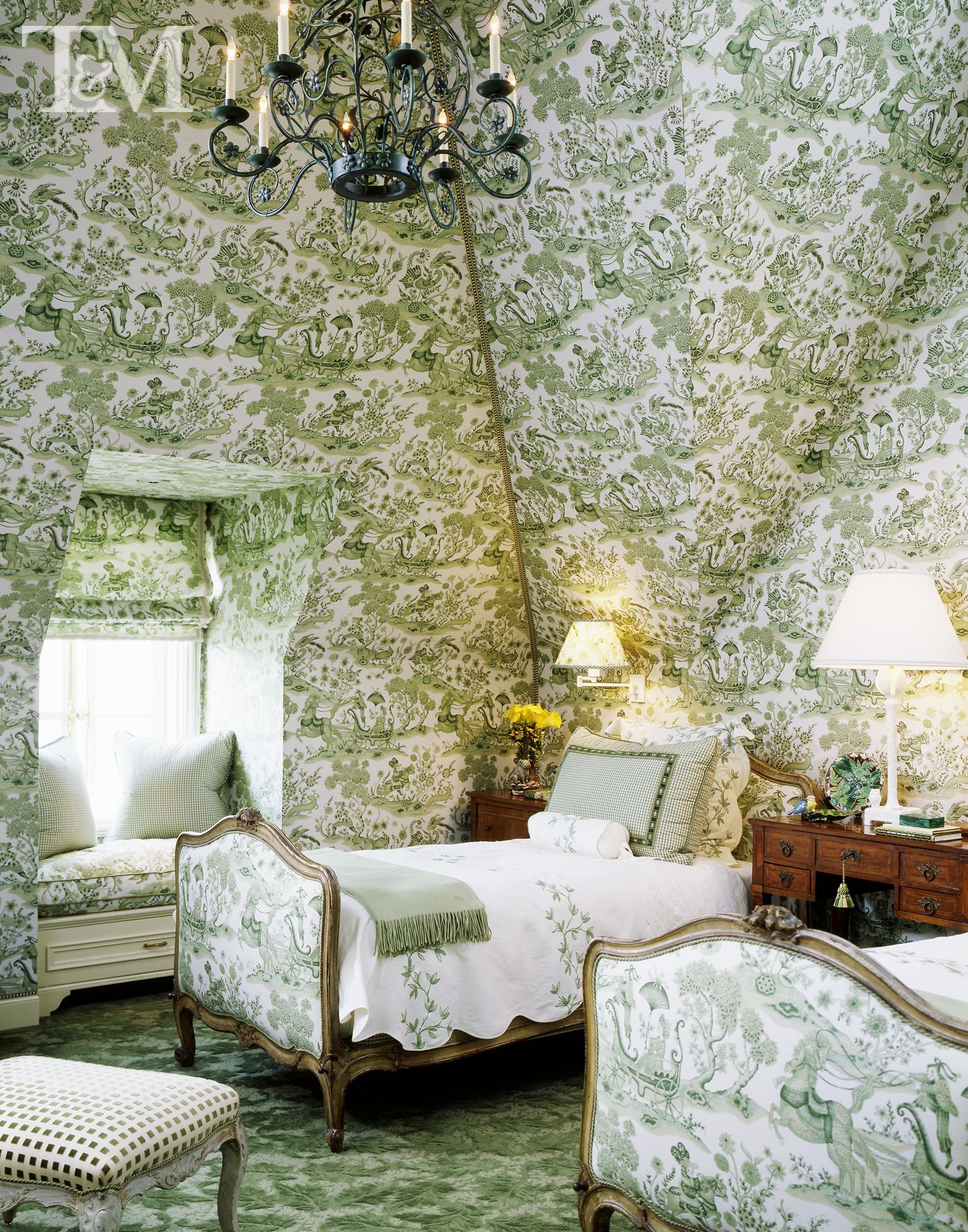 French bedroom with a very bold wallpaper design that surely catches