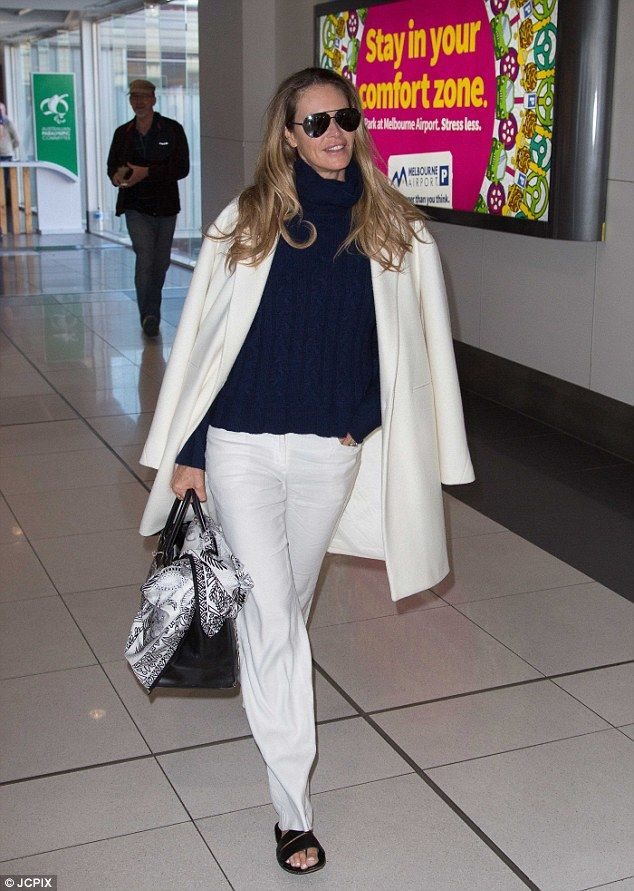 edba5aa3ee4 Work it  Elle Macpherson looked stunning as she strutted through Melbourne Airport  on Saturday morning