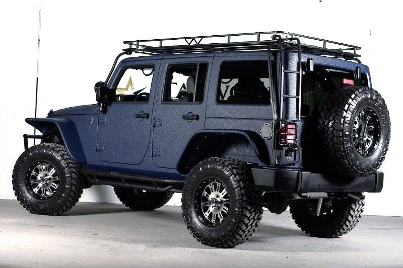 Jeep with a ladder up to the top. Perfect for getting off the beaten path and going stargazing.