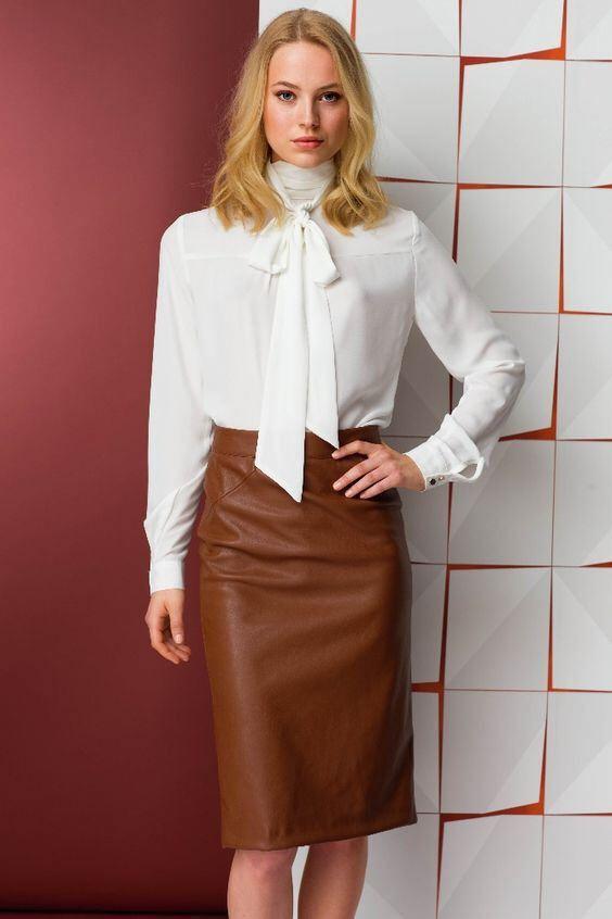 white blouse leather skirt sheldon c edward