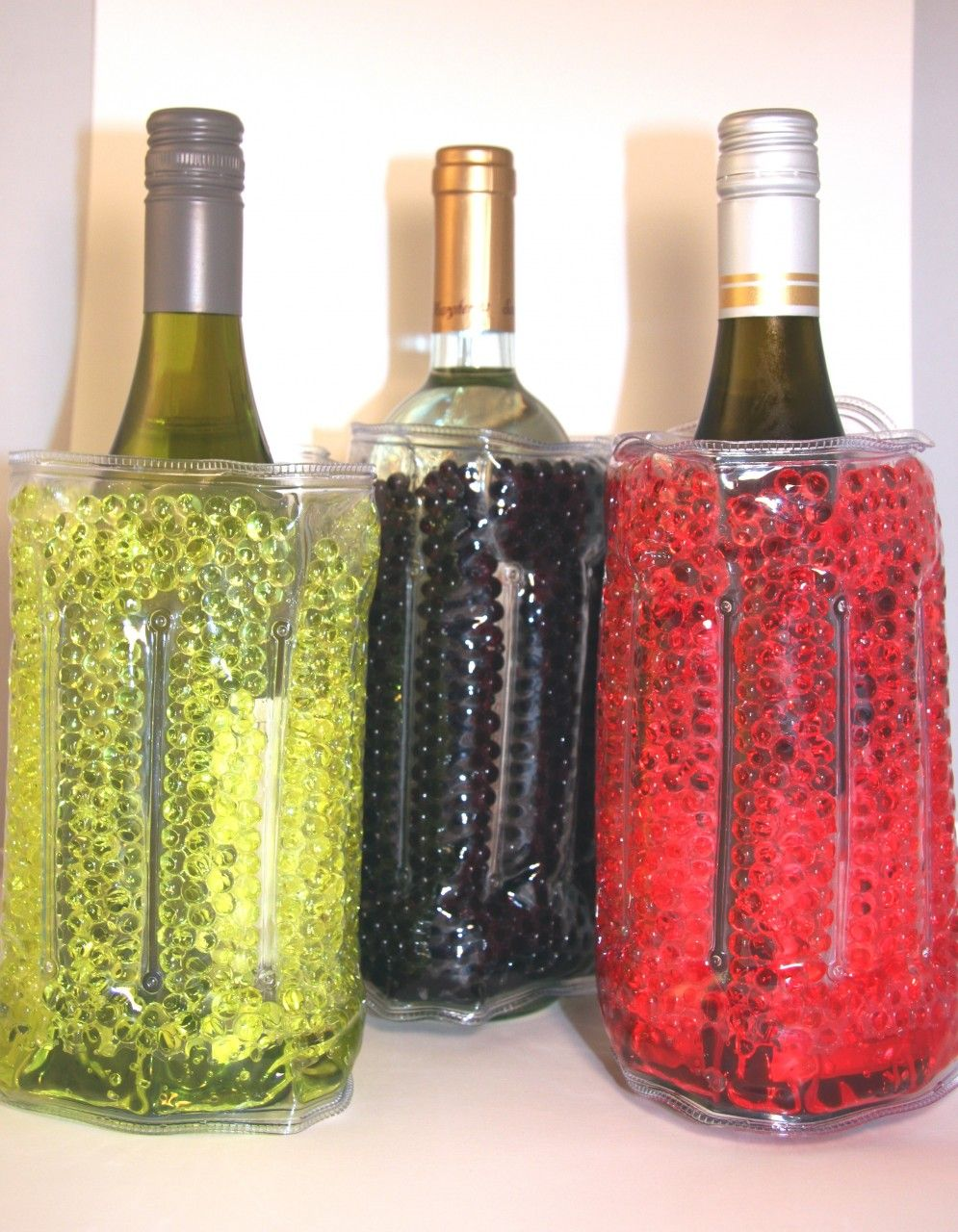 """New to Allatia Jane the """"make my day"""" Popsicooler! Essential for keeping your wine cool! Put them in your freezer and pull them out when you need a way to keep your bottle of wine the right temperature. With its velcro closure, it will tightly fit anysize bottle! We offer: red, green and black! The perfect hostess gift for anyone and everyone on your list this year! USE SHOP20 and receive 20% off today!"""