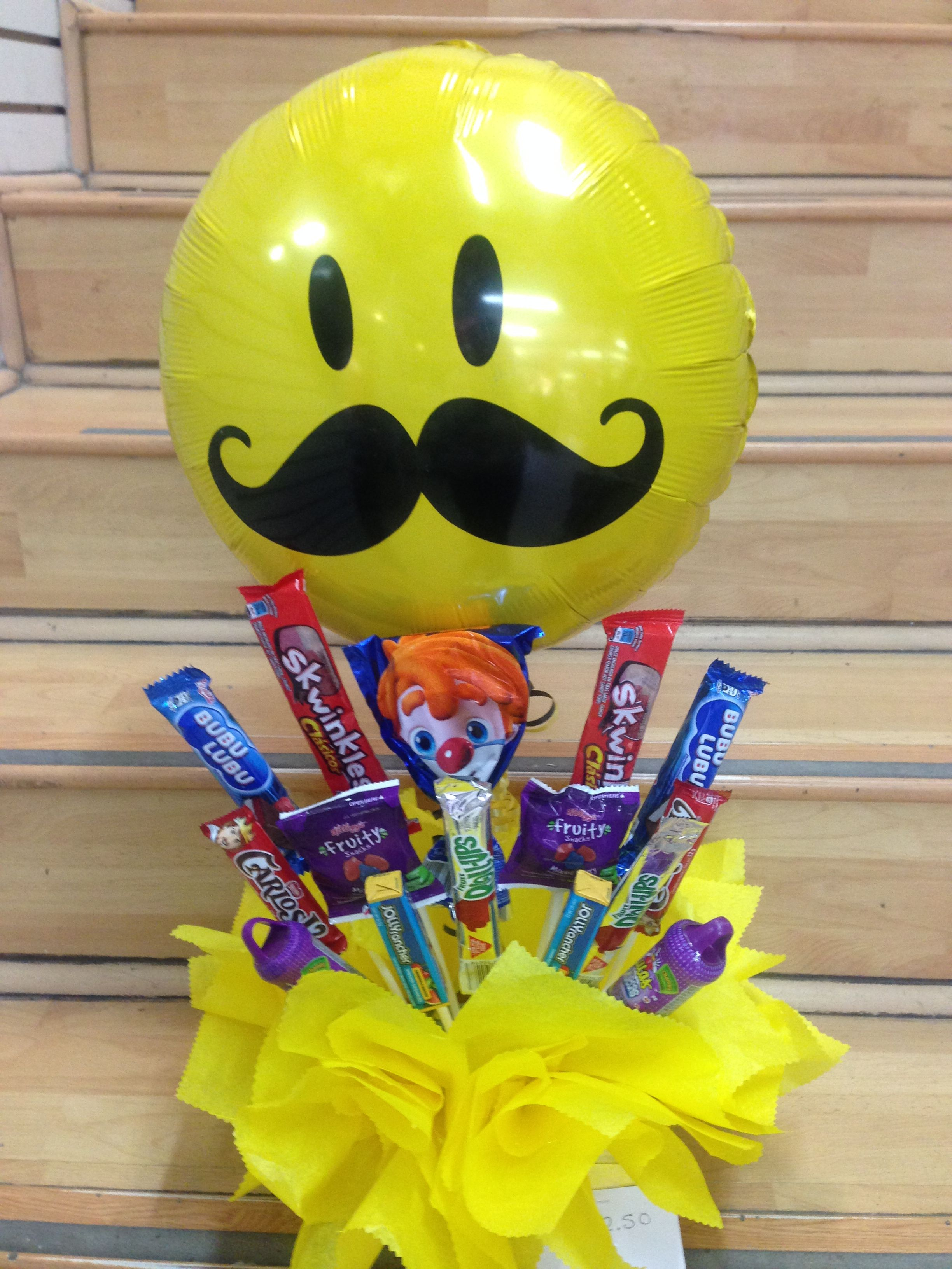Arreglo globos con dulces para cualquier ocasi n for Arreglos de mesa con dulces