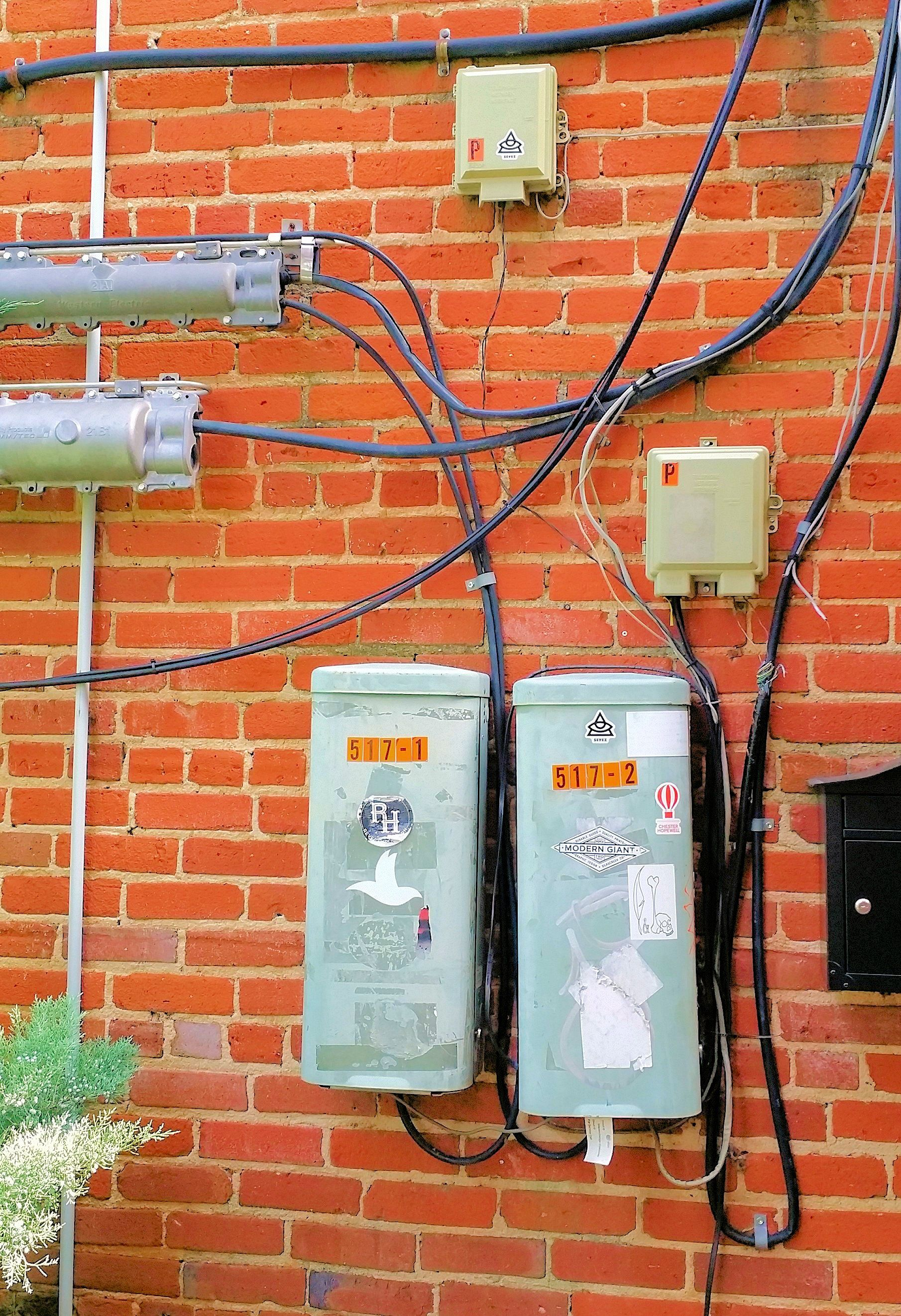 medium resolution of cable terminals splice cases outside network interfaces on side of commercial building 2015