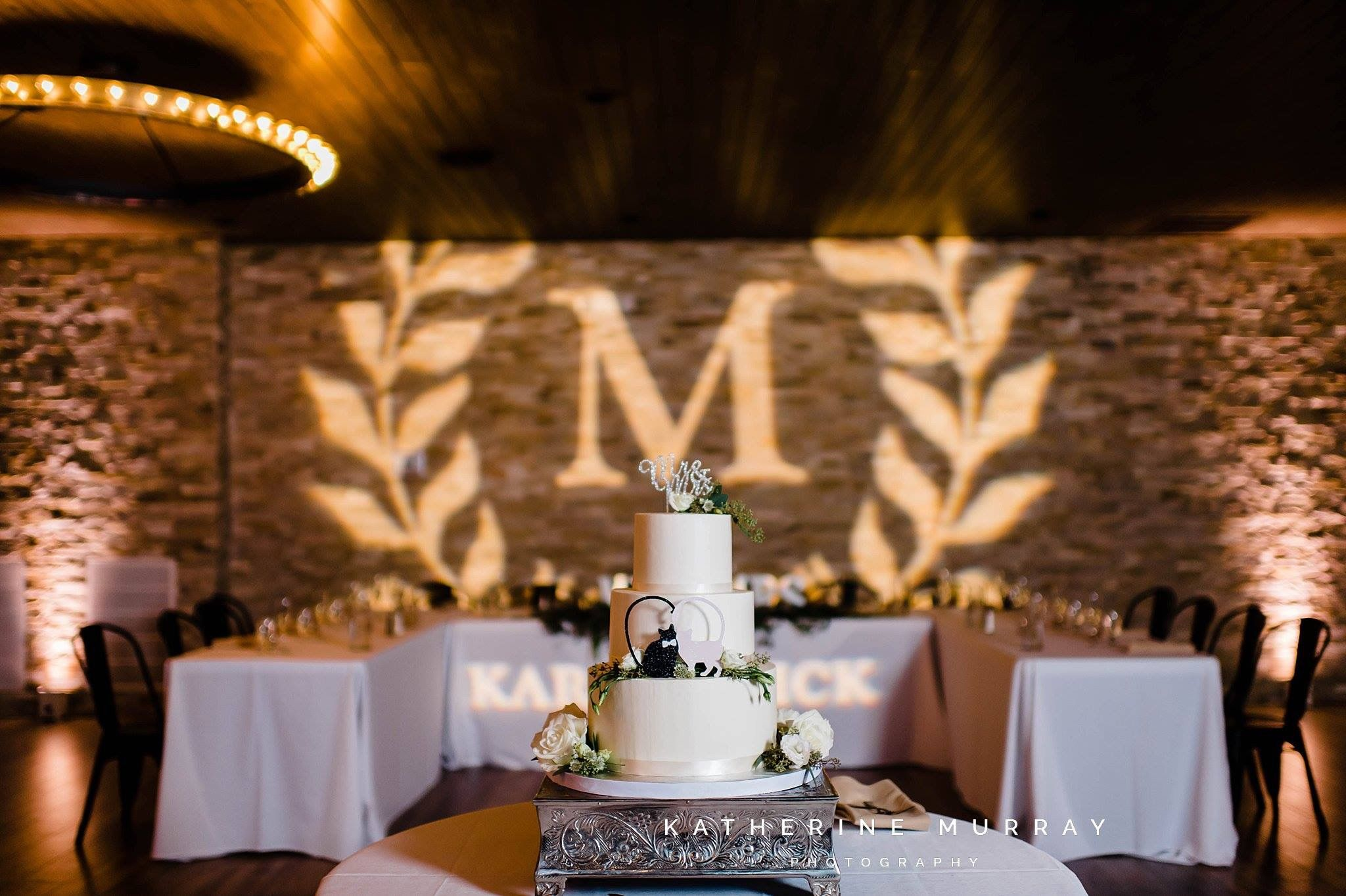 Cake and monogram in the ballroom wedding venues event