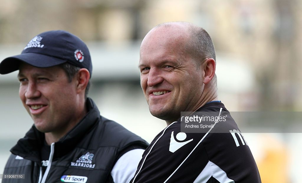 Gregor Townsend (R) Glasgow Warriors's Head Coach smiles as he looks on during the Rugby Guinness Pro12 match between Benetton Treviso and Glasgow Warriors at Monigo Stadium on April 2, 2016 in Treviso, Italy.