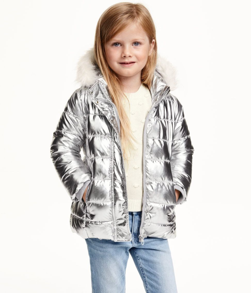 e3e17f97079e Let them shine in a metallic silver puffer jacket with hood.