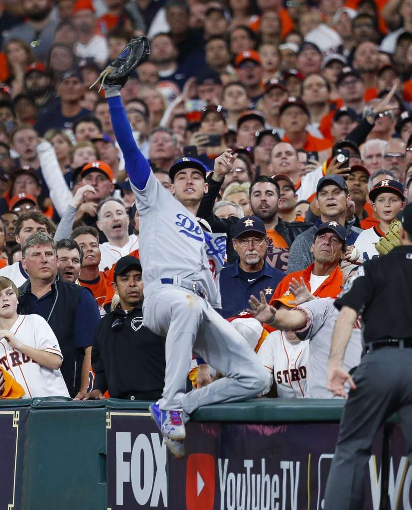 October 29, 2017: World Series Game 5 win: Astros by the numbers. Los Angeles Dodgers first baseman Cody Bellinger (35) catches a Houston Astros shortstop Carlos Correa (1) foul ball during the ninth inning of Game 5 of the World Series at Minute Maid Park on Monday, Oct. 30, 2017, in Houston. Photo: Brett Coomer/Houston Chronicle