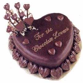 Pour Chocolate Ganache Over Heart Shaped Cake And Decorate With