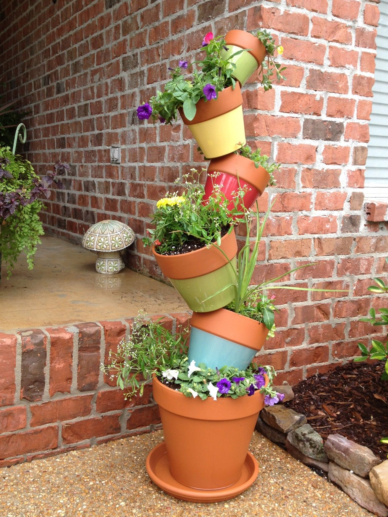Find Inspiration In 12 Diy Stacked Flower Pots For Bringing Positive Vibes In The Garden Stacked Flower Pots Flower Pots Outdoor Diy Flower Pots