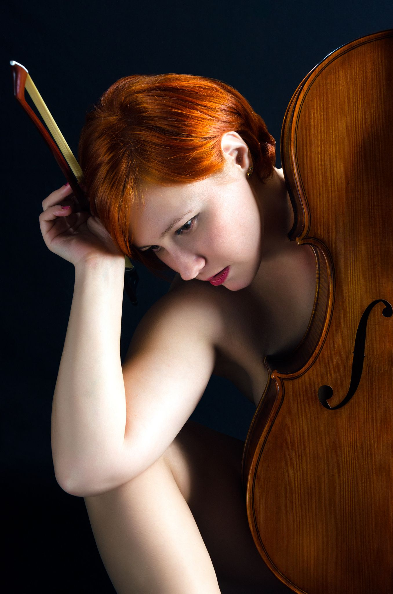 Chamber Dreams - Young girl hiding her nudity behind a cello