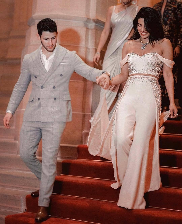 Priyankachopra Walk Down The Aisle With Her Hubby Nickjonas At Her Pre Wedding Ceremony In Priyanka Chopra Wedding Wedding Reception Outfit Bridal Jumpsuit