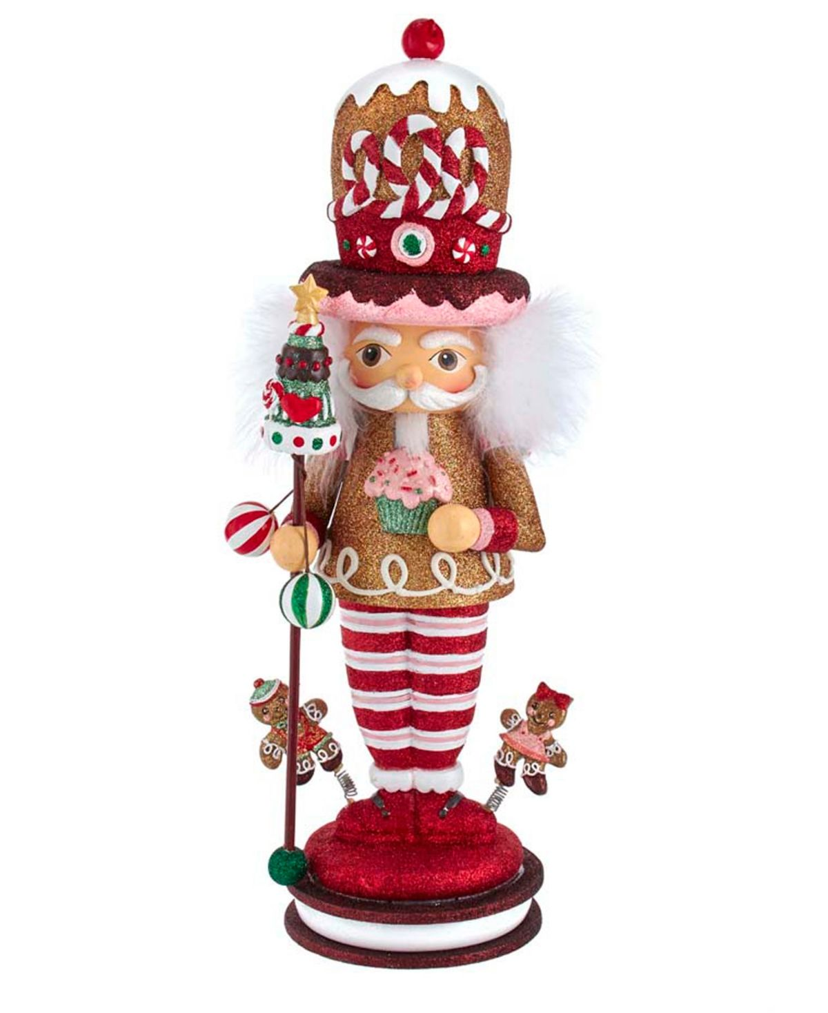 Hollywood nutcrackers is a whimsical collection of nutcrackers. This Hollywood nutcracker is the gingerbread king stands on top of a cookie sandwich with little gingered boy and girl by his side. He is holding a cupcake in his right hand and sweet Christmas tree in his left.