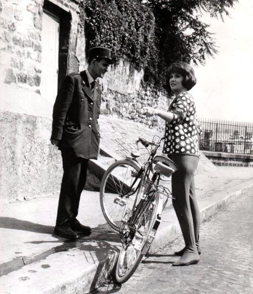 Gina Lollobrigida rides a bike, asks for directions.
