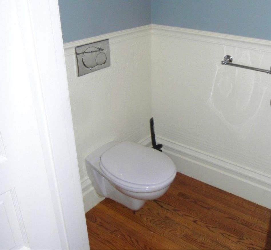 How to clean painted bathroom walls -  Gorgeous Wall Mounted Toilet Tank In White Ceramic Material And Stylish Brown Laminate Flooring Also Light Blue Wall Paint Clean Bathroom With Wall