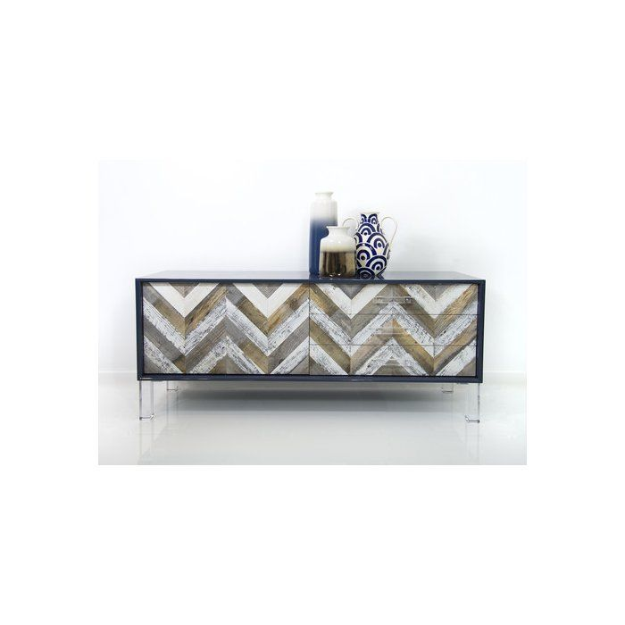 Freshen up your home with the gorgeous, coastal-inspired Capri credenza in navy gloss lacquer, featuring chevron recycled wood and Lucite legs and pulls.