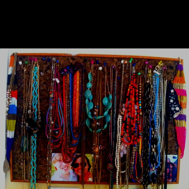 Vintage cork board with my fun necklaces pinned with tacks. Nothing special but it does add a little color