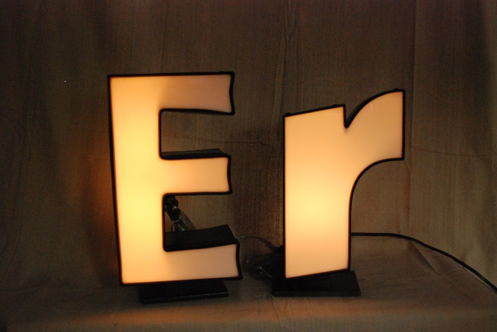 Vintage letters mounted on steel base and illuminated-switch in cord