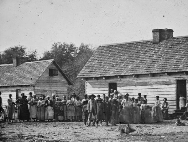 African Americans on a plantation owned by J.J. Smith in Beaufort, South Carolina, 1862. Photo by T.H. O'Sullivan. Public domain.