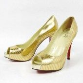 The jointed look offered by small strips of leather gives these high heel gold peep toe platform pumps a fascinating look