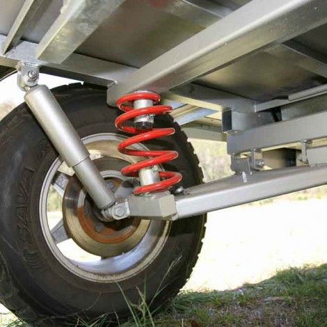 Photo of Cubs own independent trailing arm coil spring suspension. 16)
