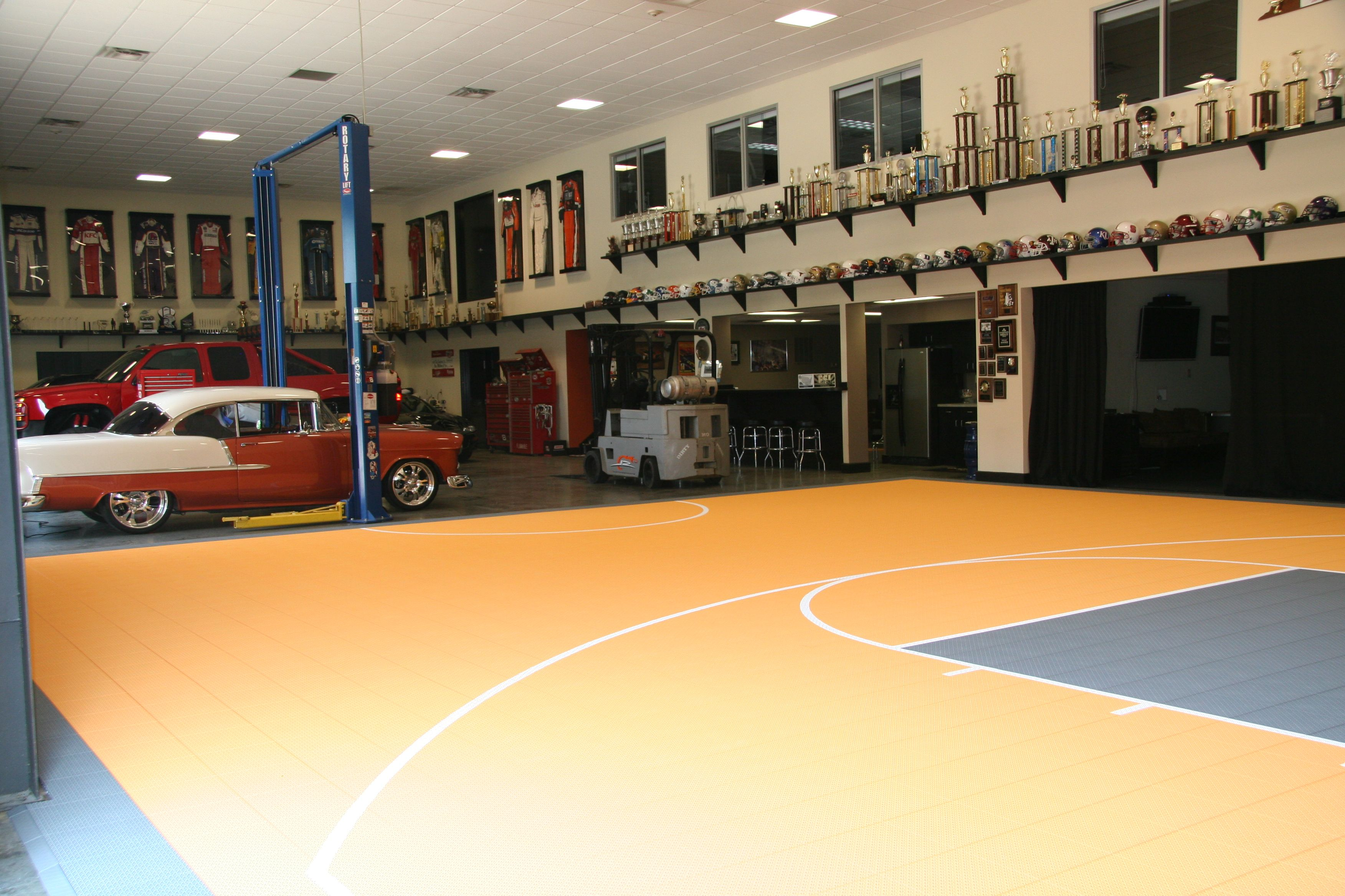 Indoor basketball court in a large warehouse type garage for Basketball hoop inside garage