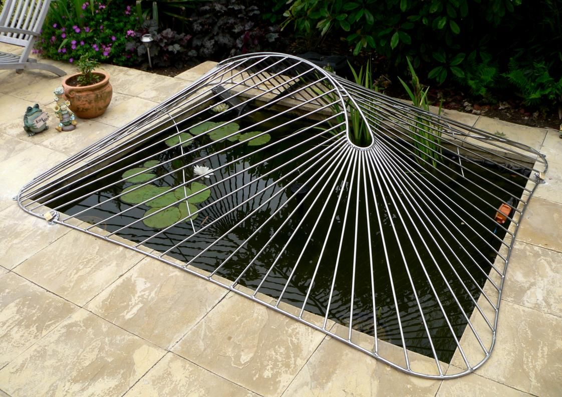 A bespoke abstract design child safety pond cover made for Koi pool cover