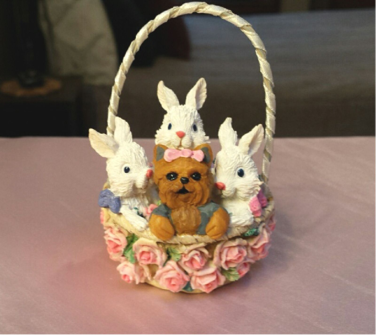 Little Yorkie joins her bunny friends in the basket :-)
