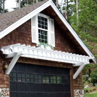 The Combination Of Black Garage Doors, Bright White Pergola, White Window  Shutters And Brown Shingles With Stone Accents Brings A Rustic Design To  This ...